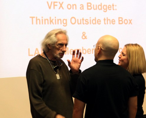 Larry Hankin speaks with presenters Steven & BenniQue Blasini before the presentations-greyscale.