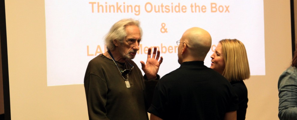 Larry Hankin speaks with presenters Steven & BenniQue Blasini before the presentations.