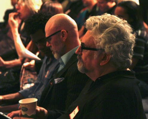 Norman Hollyn, USC Chair of the Editing Track listens to the VFX on a Budget presentation.