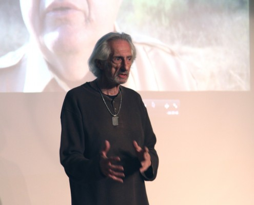 Actor Larry Hankin gives the group a little back story of the lead chartacter Emmett Sagittarius Deemus before he shows the very humorous clip.