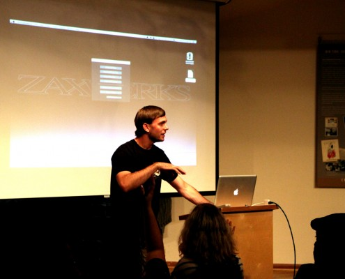 Alex Dow takes questions from the audience.