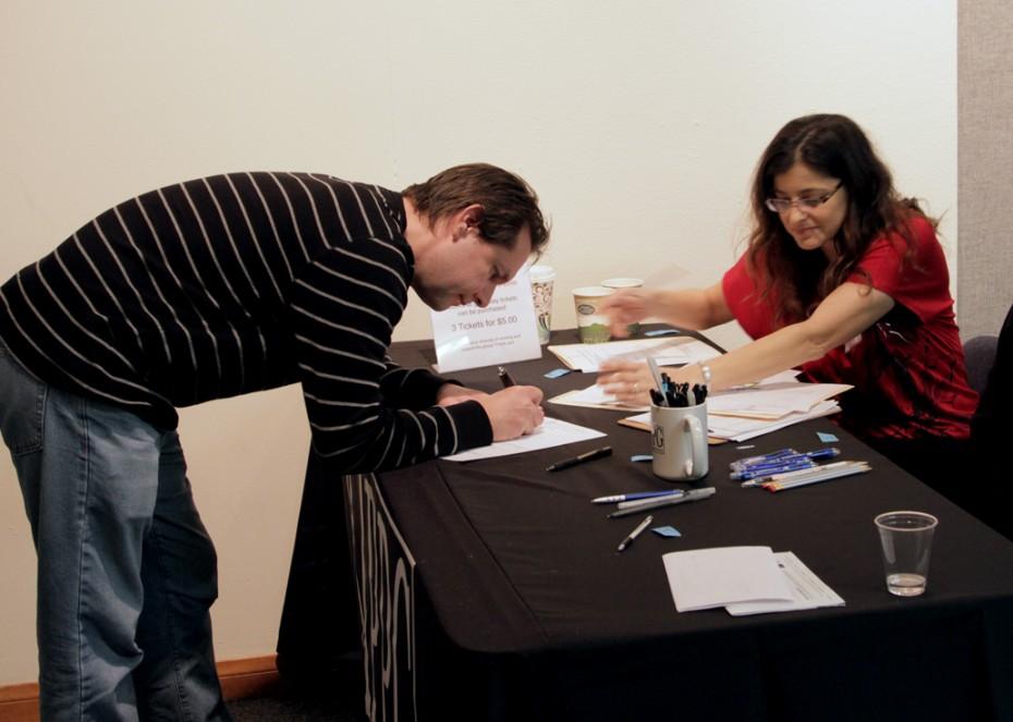 Wendy Woodhall checks in LAPPG Member Sean Blodgett.