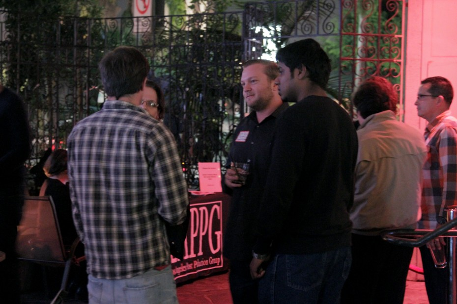 LAPPG members network in the courtyard area.