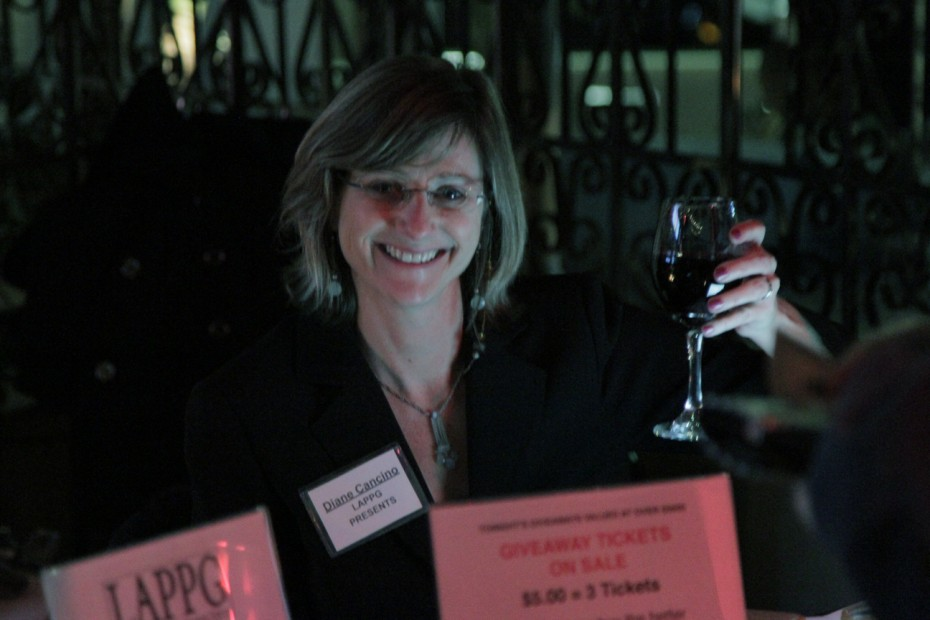 Check-in ace Diane Cancino raises a glass for a great event!