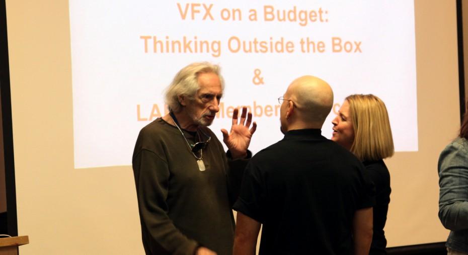 Larry Hankin speaks with presenters Steven & BenniQue Blasini before the presentations.