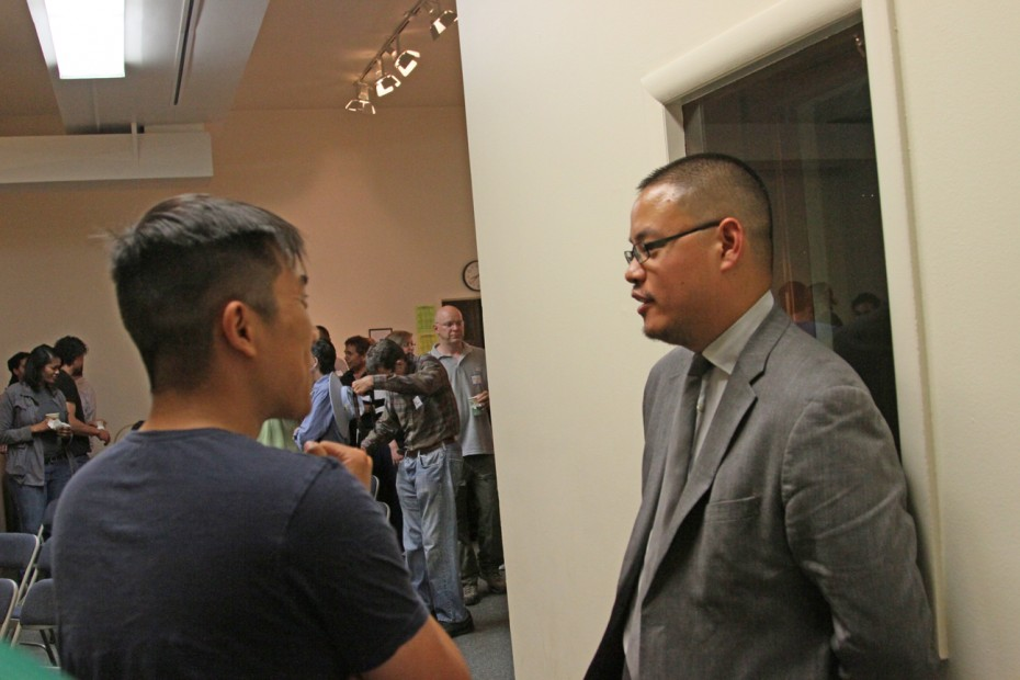 Justin Chang speaks with an audience member after his presentation.